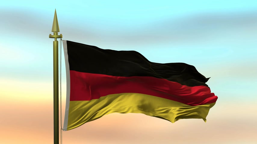 godło : National Flag of  Germany waving in the wind against the sunset sky background slow motion Seamless Loop Animation