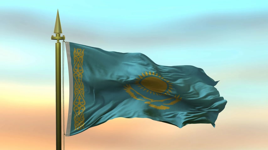 National Flag of  Kazakhstan waving in the wind against the sunset sky background slow motion Seamless Loop Animation Stok Video