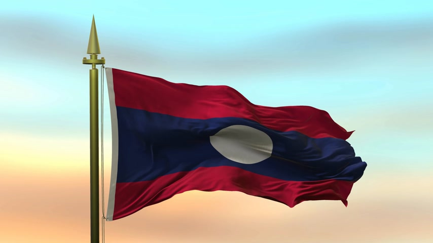 National Flag of  Laos waving in the wind against the sunset sky background slow motion Seamless Loop Animation Stok Video