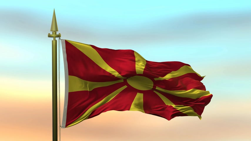 godło : National Flag of  Macedonia waving in the wind against the sunset sky background slow motion Seamless Loop Animation
