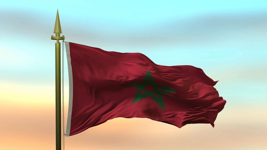 National Flag of  Morocco waving in the wind against the sunset sky background slow motion Seamless Loop Animation