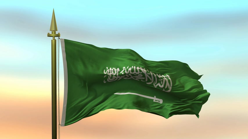arabian : National Flag of  Saudi Arabia waving in the wind against the sunset sky background slow motion Seamless Loop Animation