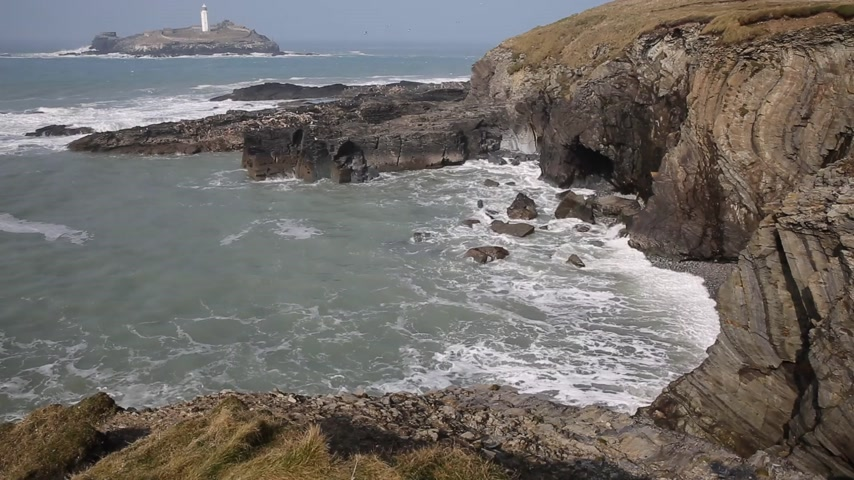 cornovaglia : Godrevy faro e l'isola di St. Ives Bay Cornwall costa Regno Unito di fronte all'Oceano Atlantico spazio di straordinaria bellezza naturale all'interno e presenta il South West Coast Path Filmati Stock