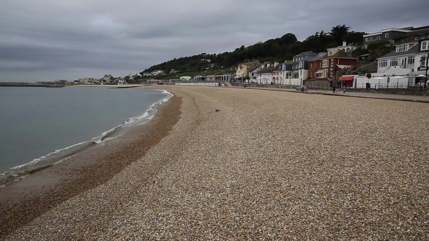 lyme : Beach at Lyme Regis Dorset England UK with waves lapping the shore Stock Footage
