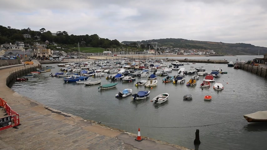 lyme : Boats moored in Lyme Regis Dorset England UK English Channel south coast on the Jurassic Coast a World Heritage Site. Stock Footage