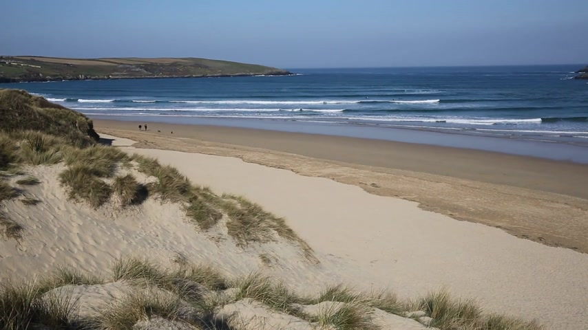 дюна : Crantock bay and beach North Cornwall England UK near Newquay and on the South West Coast Path in spring with blue sky and sea Стоковые видеозаписи