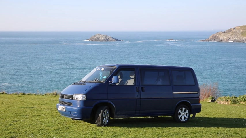 hippi : Volkswagen VW T4 Transporter Multivan also known as a Caravelle in india blue with alloy wheels a garland and devil eye lights in Crantock near Newquay Cornwall UK