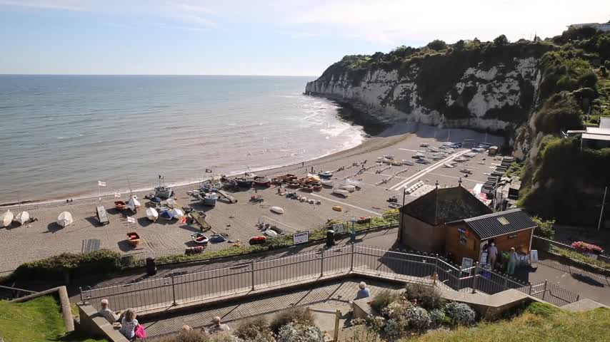 lyme : Elevated view Beer beach coast and town Devon England UK pan