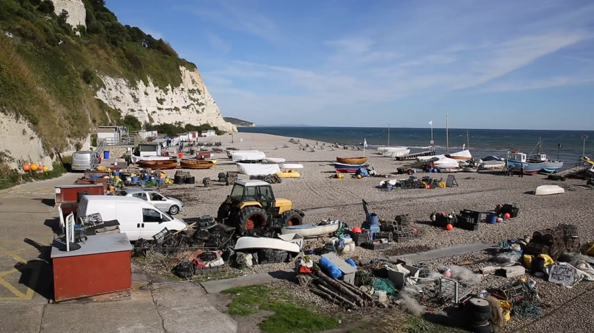 lyme : Beer beach Devon England UK with fishing equipment on Jurassic coast Stock Footage