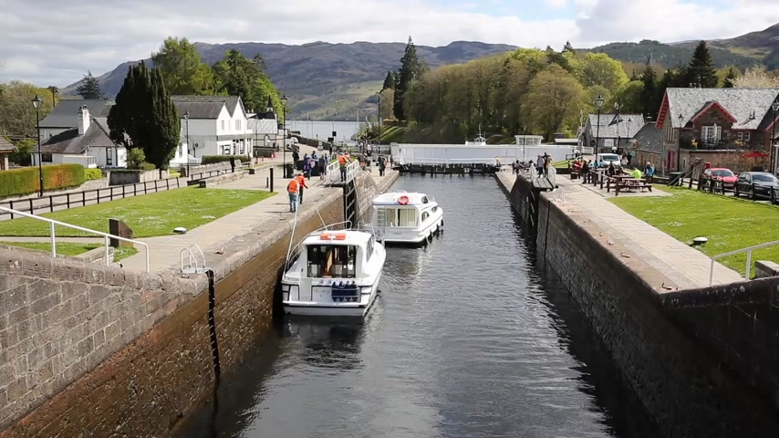 augustus : Boats moving through the lock gates on the Caledonian Canal Fort Augustus Scotland UK which connects Fort William to Inverness passing through locks to Loch Ness