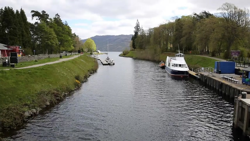 augustus : Caledonian Canal Fort Augustus Scotland UK connects Fort William to Inverness passing through locks stepping down to Loch Ness Stock Footage
