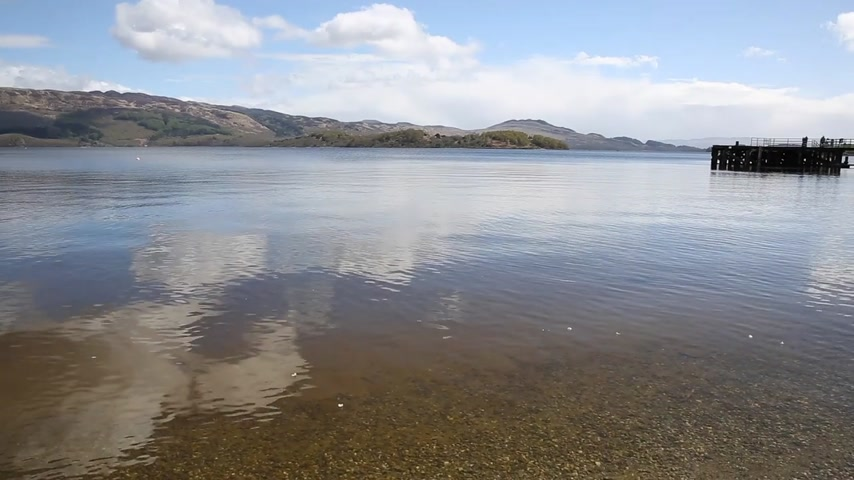 argyll : Loch Lomond Scotland UK in summer with clear water mountains and jetty popular Scottish tourist destination pan