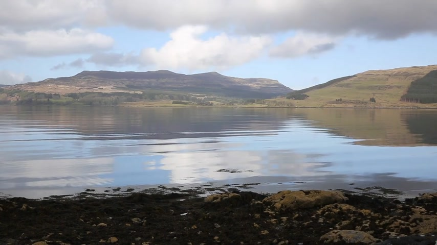 argyll : Isle of Mull Scotland UK beautiful Loch Scridain with view to Ben More and Glen More mountains on calm spring day pan