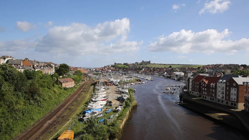 Whitby North Yorkshire England uk seaside town and tourist destination in summer with view of River Esk to Abbey and coast