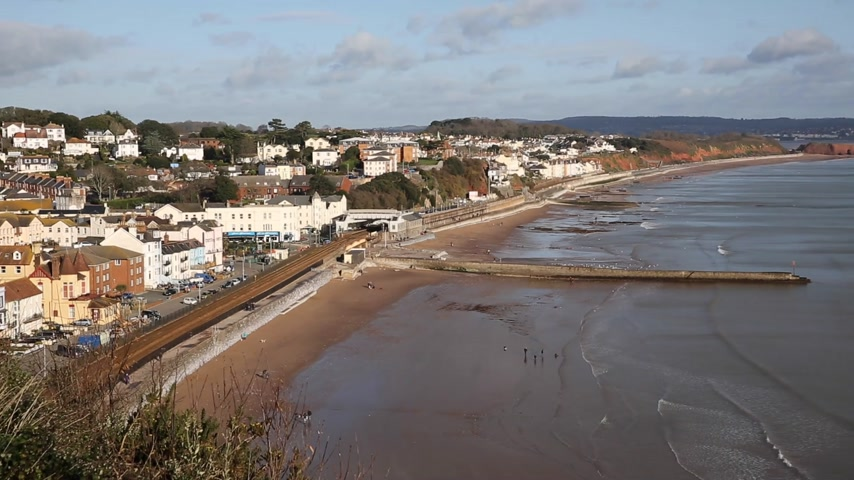 Dawlish Devon England uk English coast town with beach railway train and sea