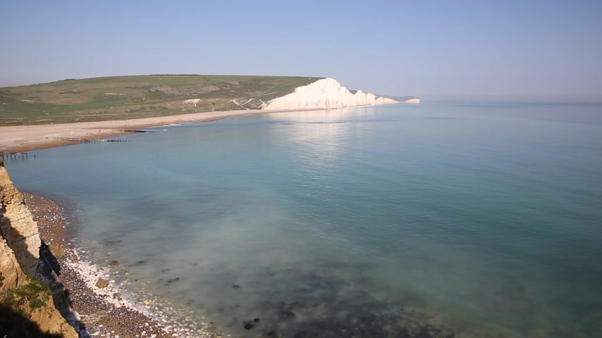 sedm : Seven Sisters chalk cliffs South Downs East Sussex uk between Seaford and Eastbourne in southern England tourist attraction on a beautiful day with blue sky and sea