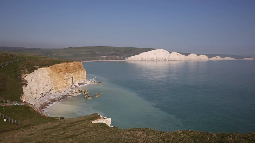 yosma : Beautiful UK coast Seven Sisters chalk cliffs East Sussex uk between Seaford and Eastbourne with clear blue sea lapping the rocks