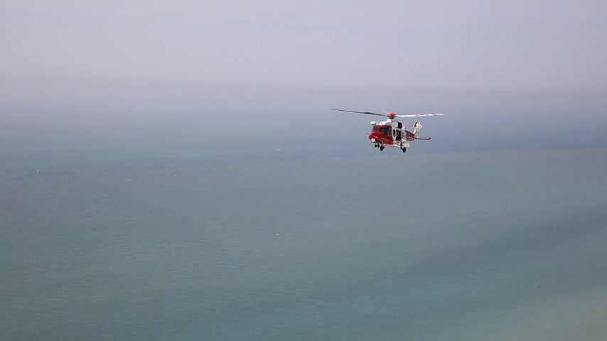 Coastguard rescue helicopter near Beachy Head East Sussex England UK
