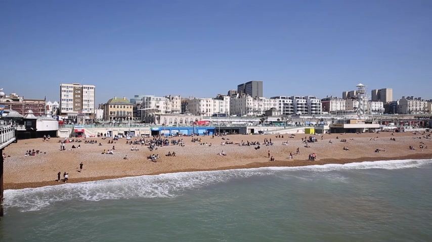 Brighton beach and sea with tourists and busy with visitors