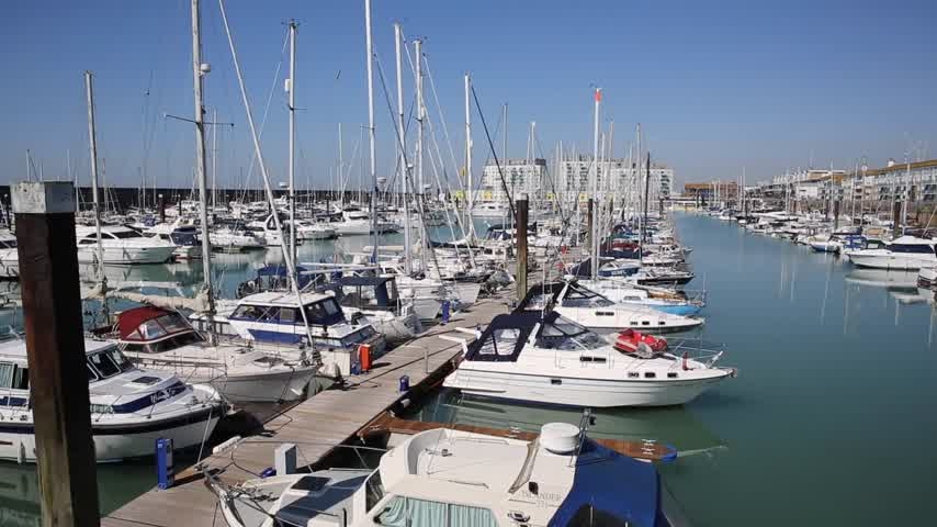 Brighton marina and harbour boats and yachts on a beautiful day in East Sussex England UK near Eastbourne Stock Footage