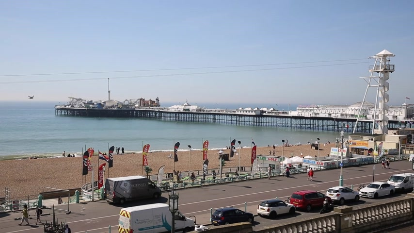 Brighton seafront beach and pier in fine weather with i360 tower in background England UK
