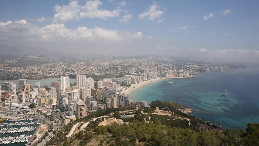 Costa Blanca coast with blue sea and apartments Calpe Spain Levante La Fossa beach Stock Footage