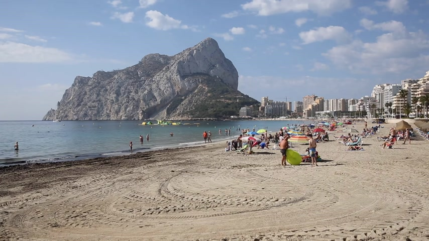 La Fossa beach Calp Spain Costa Blanca with view of the rock landmark Peñón de Ifach Stock Footage