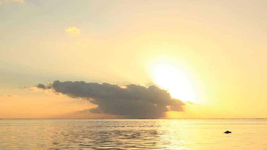 time journey : Time Lapse Sunset and Clouds over Manihi Lagoon, Tuamotus, French Polynesia  Stock Footage