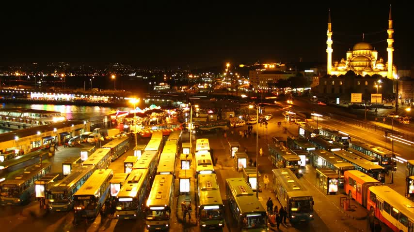 lapse : Time lapse Istanbul bus terminal at night with Mosque in background Stock Footage