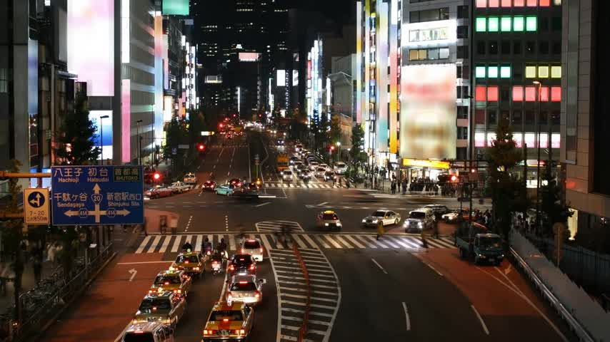 urban skyline : Time lapse Tokyo street scene at night. All trademarks and signboards are blurred. Stock Footage
