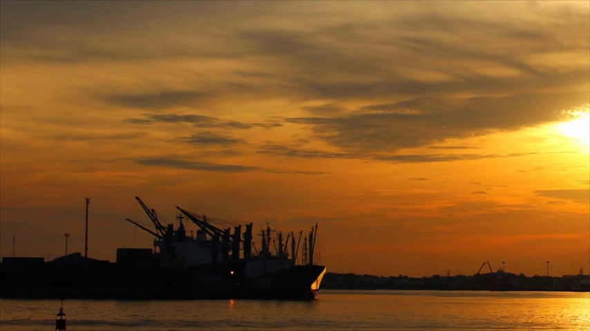 pier : Time Lapse - Shipping through sea ports and sea view in the evening , Sunset shines with water reflection Stock Footage