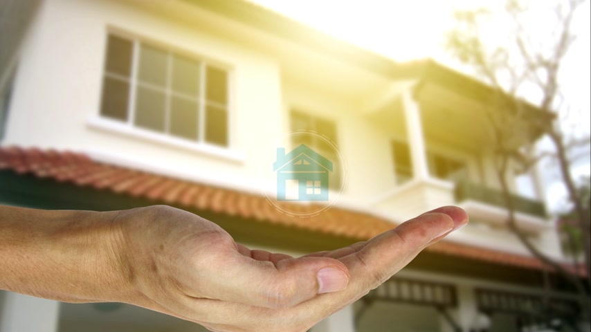 real : Hand holding with property investment icons over the Network connection on property background, Property investment concept. Stock Footage