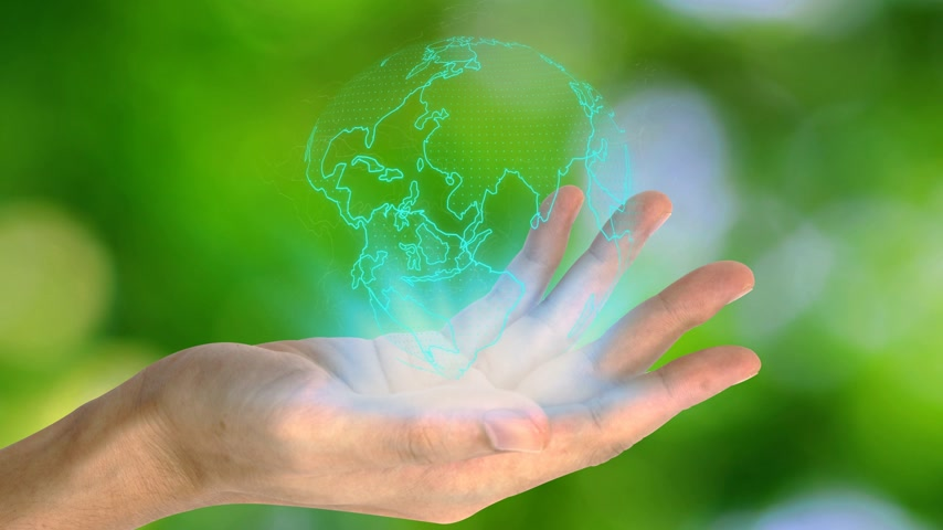 global iş : Hand holding with earth virtual screen icon over the Network connection on nature background, Technology ecology concept.