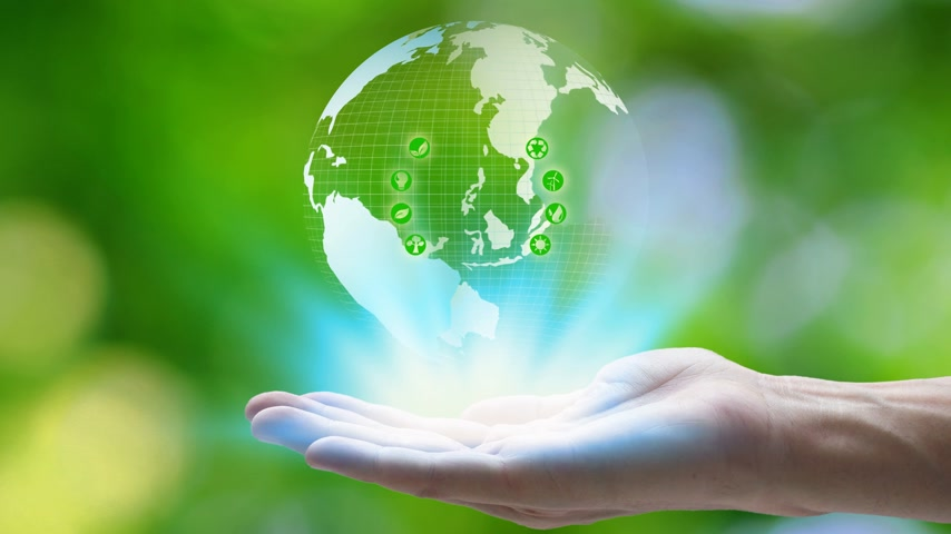 fejlesztés : Hand holding with earth and environment icons over the Network connection on nature background, Technology ecology concept.