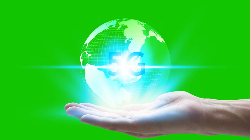 jel : hand holding network using 5G technology with virtual screen icons on a green screen background, Technology Internet 5G global network concept. Stock mozgókép