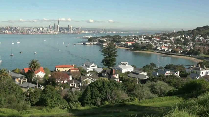north bay : view from North Head reserve over Devenport surburb and beaches with the city of Auckland in the distance Stock Footage