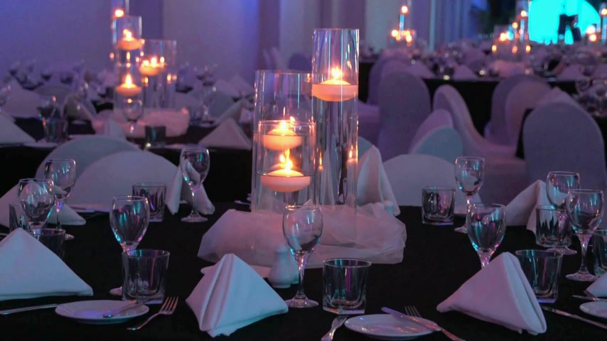 função : New Zealand. A themed evening dinner table set up for a Conference or wedding venue, candles lit with shallow depth of field