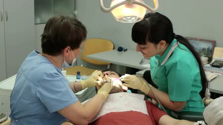seringa : Treatment of caries. Man visits the dentist.