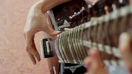 musically : Indian music. Musician playing a musical instrument - sitar Stock Footage