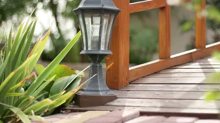 exterior : The wooden bridge over an artificial pond. The garden lantern. Stock Footage