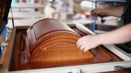 kitchen furniture : The gluing edges. The manufacturing process of the facade of kitchen furniture.