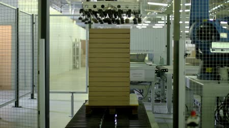 packaging : Furniture manufacturing. Furniture parts are packaged on an automated packaging line