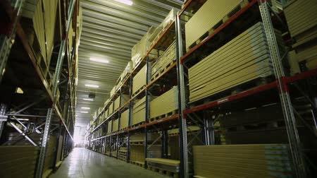 bútor : Warehouse storage of furniture. Racks with packed details of furniture.