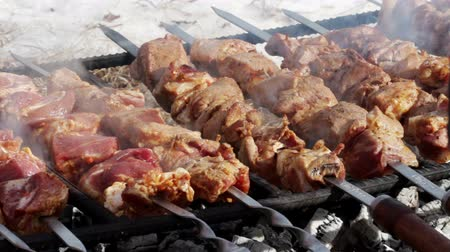 etli : Cooking of pork shashlik on skewers on the grill