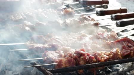 espetos : Cooking of pork shashlik on skewers on the grill