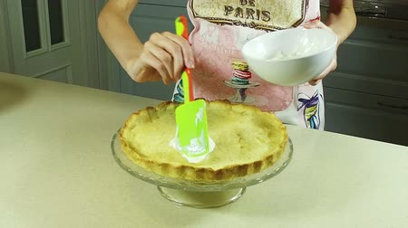 flan : Cooking a pie. Woman spreading a cream on the baked dough. Slow motion. HD Stock Footage