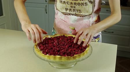 tartlet : Cooking a pie. A woman filling a baked dough with fresh berries. Slow motion. HD