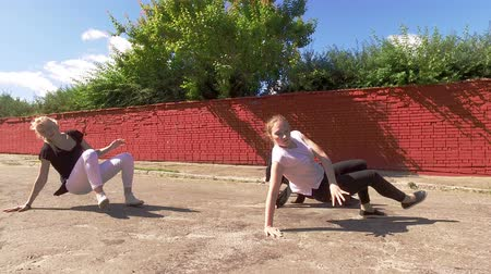 break dance : The art of dance. Group of four young people dancing in the street. 4K Stock Footage