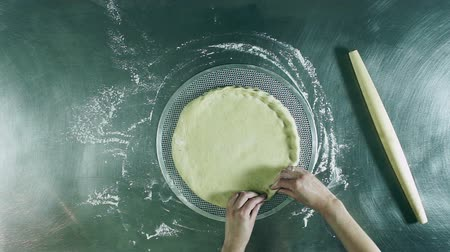 fırınlama : Cooking pizza. Female hands kneading dough, preparing a pizza base. Top view. HD