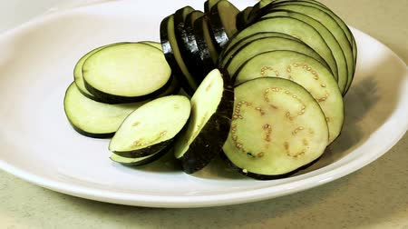 diety : Fresh vegetables. Panorama of the aubergine sliced into pieces on the white plate. HD